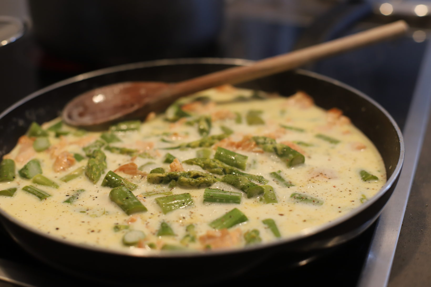 salmon asparagus pasta sauce in pan